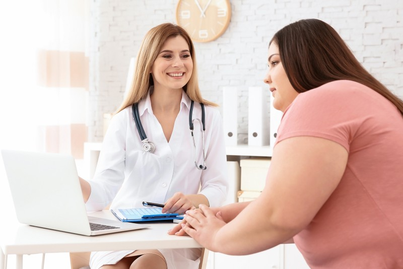 Physician consults an overweight woman